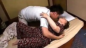 Busty granny is giving a masseur a double blowjob